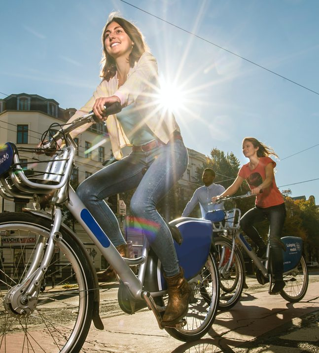 girls riding a bicycle